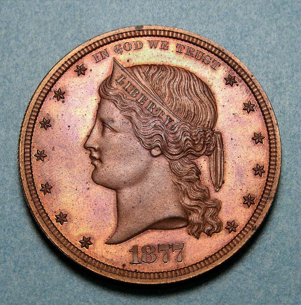 United States One Dollar, Pattern, 1877, United States Mint, Philadelphia. Obverse: Liberty head with coronet facing left, date below. Reverse: Denomination in a cereal wreath. William Barber designed this pattern. Only a half-dozen,including this one, are known. [reference no. Judd 1544]