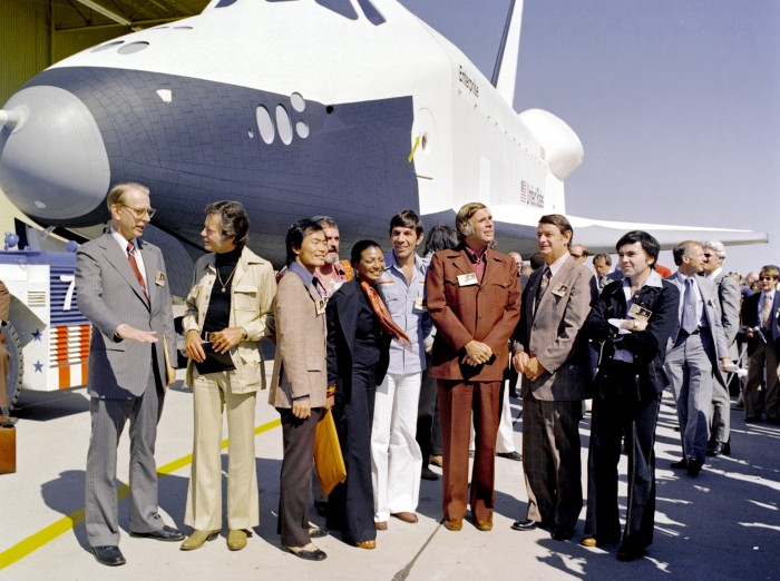 Cast of the original Star Trek television show and NASA officials with test space shuttle Enterprise in 1976.