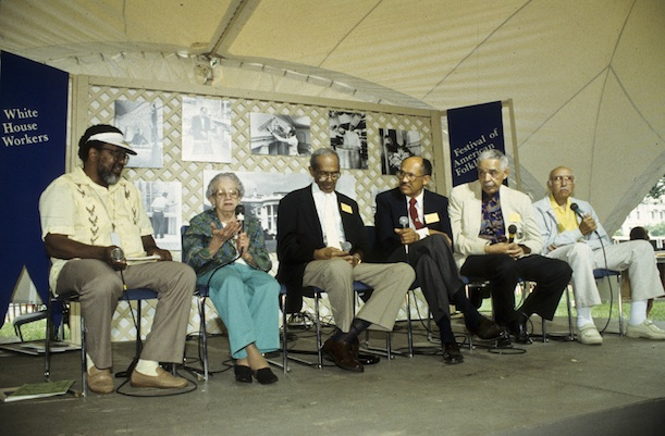 Worth Long, left, moderates a discussion of former White House Workers during the 1992 Festival of American Folklife. Eugene Allen is fourth from the left. (Photo courtesy Smithsonian Center for Folklife and Cultural Heritage)