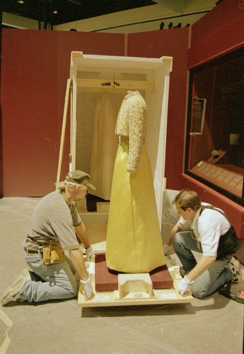 """The inaugural gown worn by Patricia Ryan Nixon in 1969 is being unpacked from its shipping crate at the Los Angeles Convention Center. The Convention Center was the first stop of the """"America's Smithsonian"""" exhibition national tour celebrating the Smithsonian's 150th anniversary. The exhibition opened in Los Angeles on February 9, 1996."""
