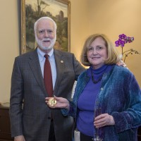 Pamela Henson receives the Secretary's Award for Exceptional Service from Secretary Wayne Clough.