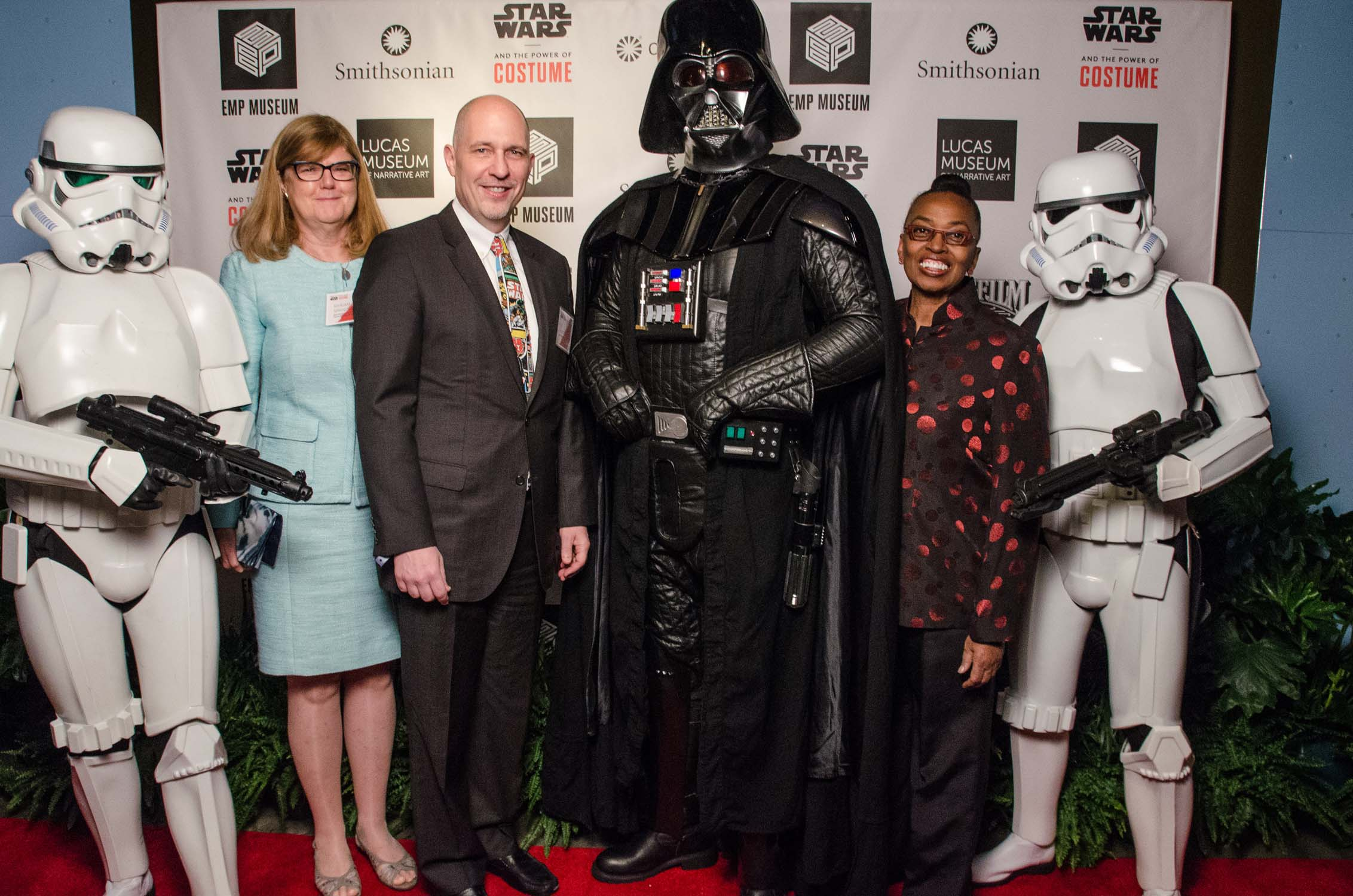 From left, unidentified Imperial stormtrooper; Myriam Springuel, interim director of the Smithsonian Traveling Exhibition Service; Acting Secretary Al Horvath; Supreme Commander of the Imperial Forces Darth Vader; Claudine Brown, Assistant Secretary for Education and Access; and an unidentified Imperial stormtrooper. (Photo by Brady Harvey, courtesy of EMP Museum)