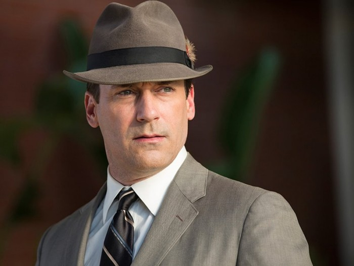 "Actor Jon Hamm sporting the iconic fedora and gray suit of his alter ego, Don Draper, from the popular television show ""Mad Men."" Draper's suit and fedora, along with Betty Draper's yellow housedress and other props were donated to the Smithsonian. (Photo courtesy AMC, Mad Men)"