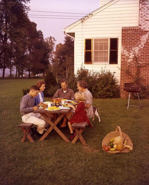 A family enjoying the fruits of harvest, 1960. (Photo by Molly Adams, courtesy of Archives of American Gardens)