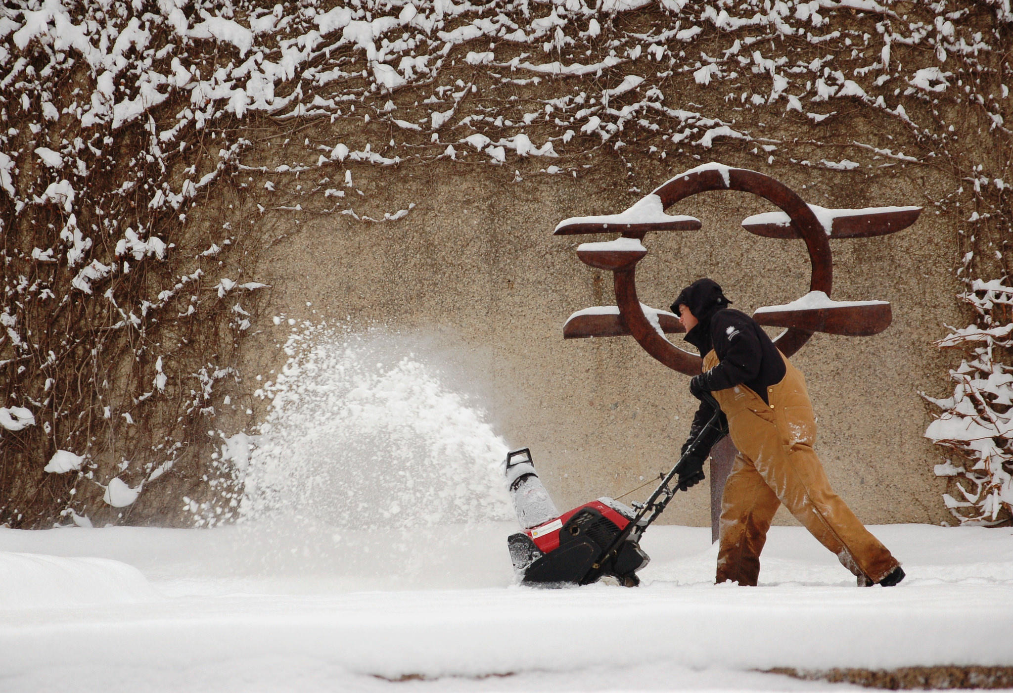 A member of the Smithsonian Garden staff clears snow in the Hirshhorn Sculpture Garden. (Photo courtesy Smithsonian Gardens)