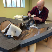 Preparator Alan Zdinak sets up to build a storage jacket for the ground sloth's pelvis.