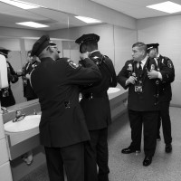 Honor Guard members checking their uniforms