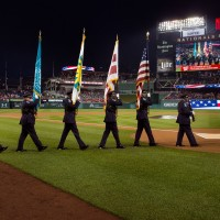 The Smithsonian Honor Guard takes the field at Nationals Park June 3, 2015.