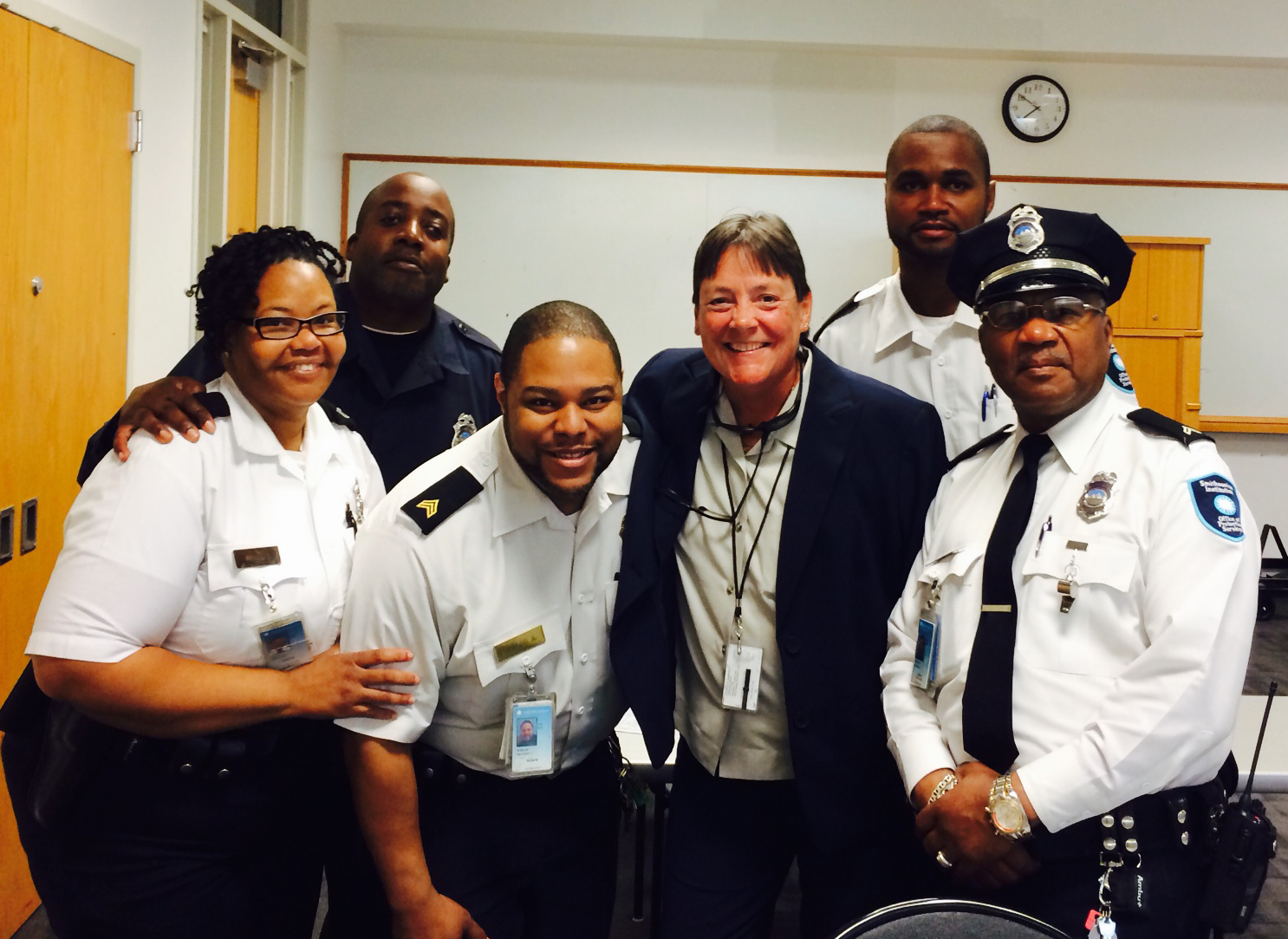 Dee Walker (fourth from left) with officers from the Office of Protective Services.