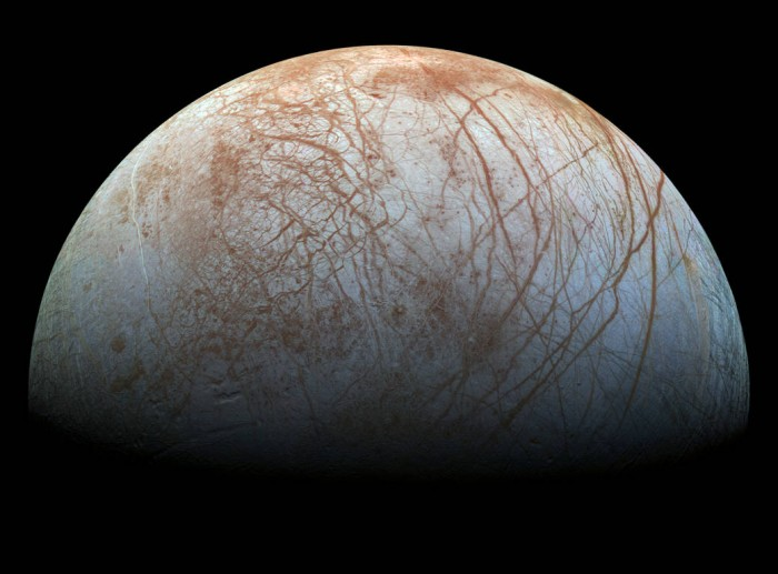The puzzling, fascinating surface of Jupiter's icy moon Europa looms large in this newly-reprocessed color view, made from images taken by NASA's Galileo spacecraft in the late 1990s. The scene shows the stunning diversity of Europa's surface geology. Long, linear cracks and ridges crisscross the surface, interrupted by regions of disrupted terrain where the surface ice crust has been broken up and re-frozen into new patterns. (Image credit: NASA/JPL-Caltech/SETI Institute)