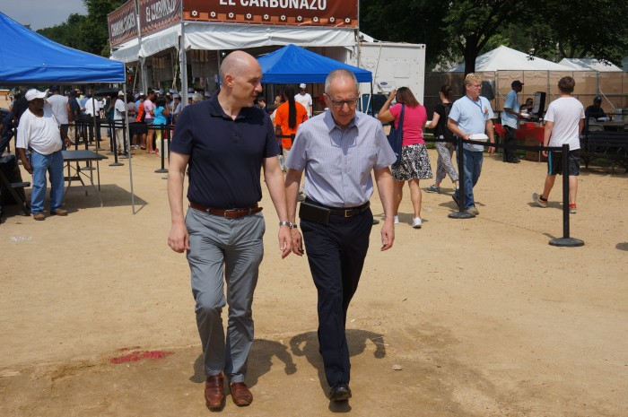 Al Horvath, left, and Secretary Skorton stroll through the Folklife Festival on their way to the picnic. (Photo by John Gibbons)