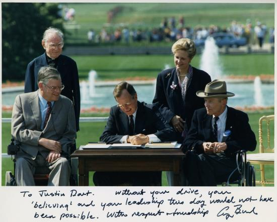 Justin Dart, in cowboy hat, at the signing of the Americans with Disabilities Act. (Photo courtesy of Yoshiko Dart)