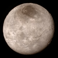 Remarkable new details of Pluto's largest moon Charon are revealed in this image, taken from a distance of 289,000 miles. A swath of cliffs and troughs stretches about 600 miles from left to right, suggesting widespread fracturing of Charon's crust, likely a result of internal processes. At upper right, along the moon's curving edge, is a canyon estimated to be 4 to 6 miles deep. Credit: NASA/JHUAPL/SWRI