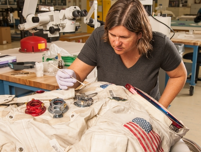 Lisa Young, objects conservator at the National Air and Space Museum, works on Neil Armstrong's Apollo 11 spacesuit in the Emil Buehler Conservation Laboratory. Credit: Image by Dane Penland, Smithsonian Institution