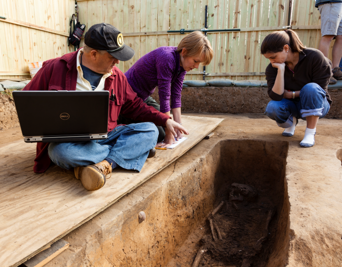Smithsonian forensic anthropologists Doug Owsley and Kari Bruwelheide and colleague Ashley McKeown examine the grave of Rev. Robert Hunt. In July 2015, a team of scientists from the Smithsonian's National Museum of Natural History and Jamestown Rediscovery announced the identities of Rev. Robert Hunt, Capt. Gabriel Archer, Sir Ferdinando Wainman and Capt. William West, high-status leaders who helped shape the future of America during the initial phase of the Jamestown colony. (Photo by Donald E. Hurlbert / Smithsonian Institution)