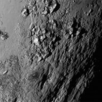 This close-up image of a region near Pluto's equator reveals a giant surprise: a range of youthful mountains rising as high as 11,000 feet above the surface of the icy body. The mountains likely formed no more than 100 million years ago -- mere youngsters relative to the 4.56-billion-year age of the solar system -- and may still be in the process of building. Credit: NASA/JHUAPL/SWRI