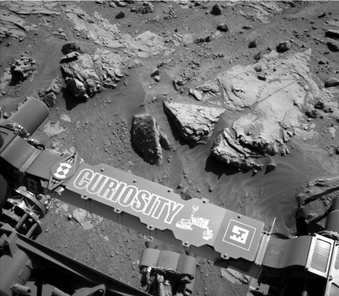 """This image from the Navigation Camera on NASA's Curiosity Mars rover shows a sandstone slab on which the rover team has selected a target, """"Windjana,"""" for close-up examination and possible drilling. The target is on the approximately 2-foot-wide (60-centimeter-wide) rock seen in the right half of this view. The Navcam's left-eye camera took this image during the 609th Martian day, or sol, of Curiosity's work on Mars (April 23, 2014). The rock is within a waypoint location called """"the Kimberley,"""" where sandstone outcrops with differing resistance to wind erosion result in a stair-step pattern of layers."""