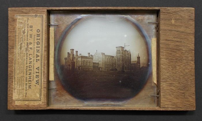 Lantern slide photograph on glass in wood mount of Smithsonian Institution Building under construction, William Langenheim (1807 - 1874) and Frederick Langenheim (1809-1879) Philadelphia, 1850. Smithsonian Castle Collection, gift of Tom Rall, Arlington, Virginia