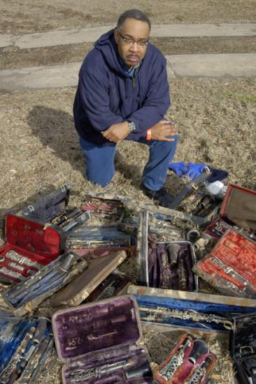 Dr. Michael White with his ruined clarinet collection. (Photo by Hugh Talman)