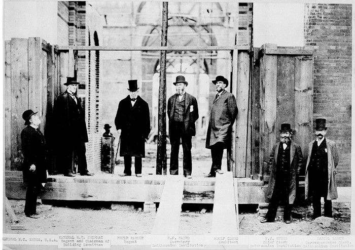 The building committee for the U.S. National Museum included architect Adolf Cluss, Gen. William Tecumseh Sherman and other important figures of the day. From left, Gen. M.C. Meigs; Gen. W.T. Sherman, Regent and Chairman of the Building Committee; Regent Peter Parker; Smithsonian Secretary Spencer F. Baird; Architect Adolf Cluss; W.J. Rhees, Chief Clerk of the Smithsonian; and Daniel Leech, Smithsonian Institution correspondence clerk. (Via Smithsonian Institution Archives)