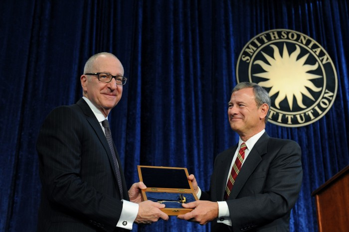 Dr. David Skorton receives the ceremonial key to the Smithsonian from Chief Justice of the United States John Roberts, Oct. 19, 2015. (Photo by Joyce Boghosian)