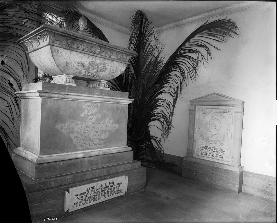 Crypt containing the body of founder James Smithson in the North Tower entrance of the Smithsonian Institution Building or Castle. Smithson's remains were brought to the United States by Smithsonian Regent Alexander Graham Bell in 1904, when the Protestant Cemetery in Genoa, Italy, where Smithson was buried, was to be moved. Many plans were made for an elaborate memorial to the Institution's benefactor, but the lack of an appropriation dictated a more modest course. Smithson's marker from the Italian gravesite was incorporated into the room, and a gate was fashioned from pieces of the fence that had surrounded the site. Architects Hornblower and Marshall redesigned the room to give it a more somber classical feeling, replacing the ceiling, windows, and the floor. (Photographer unknown, 1905)