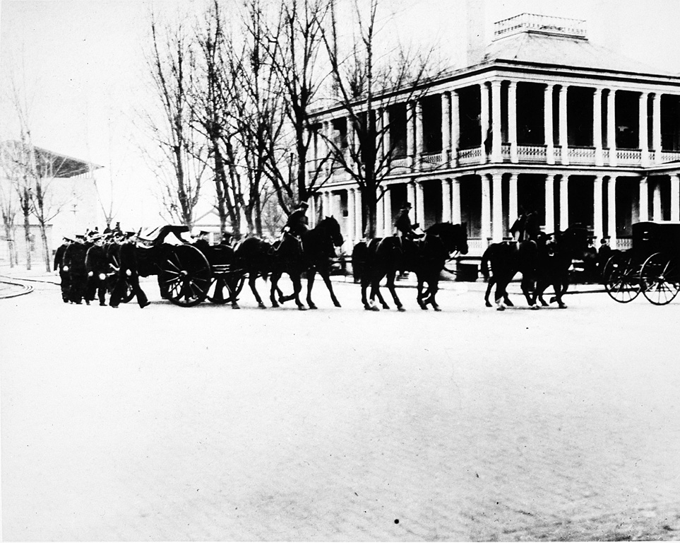 Military cortege accompanies James Smithson's remains from the Washington Navy Yard to the Smithsonian, on January 23, 1904. This image shows the Marine caisson as it makes its way with procession of individuals on foot, on horses, and horse and carriage. James Smithson (c.1765-1829) died in Genoa, Italy, and was buried there. However, after the turn of the century, the Smithsonian was notified that the graves were to be moved to allow quarrying on the cemetery site. Smithsonian Regent Alexander Graham Bell and his wife Mabel traveled to Italy to oversee the disinterrment of Smithson's remains and their transportation to the Institution in Washington, D.C., that his bequest created. (Photographer unknown, 1904)