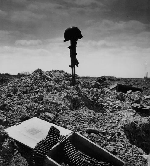 Soldier's memorial after the Battle of Normandy during World War II. Courtesy of the National Archives.
