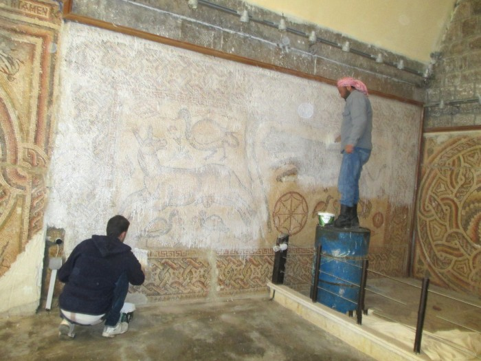 Volunteers covered mosaics in the Ma'arra Museum in Syria with a protective layer of glue and cloth designed to fortify and keep the tesserae together and protect the ancient mosaics from further damage caused by the ongoing conflict in that country. Several truckloads of sandbags were then laid out to protect the mosaics from damage caused by further attacks. (Image courtesy Penn Cultural Center at the University of Pennsylvania Museum)