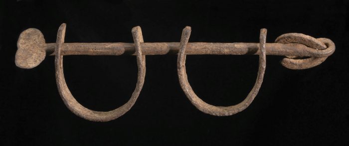 Middle Passage Shackles (wrought iron), c. pre-1863 Ankle shackles of the type used to restrain enslaved people aboard ships crossing the Atlantic from Africa to the Americas, during the Middle Passage.