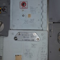 While 3D scanning the Apollo 11 Command Module Columbia, museum staff uncovered writing on its interior walls. On this panel, numbers and other notations copied from mission control voice transmissions were recorded in pen or pencil, just to the left of where command module pilot, Michael Collins, would have stood using the spacecraft's sextant and telescope for navigation. Audio and recorded transcripts of those communications can be compared with these numbers to suggest when and by whom they were written.