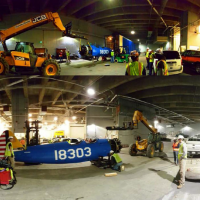 Workers prepare to carefully lift the Boeing biplane to its permanent home suspended from the ceiling of the museum, December 2015 (Photo by Carlos Bustamante)