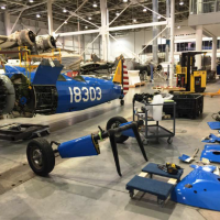 The dismantled Boeing-Stearman PT-13D Kaydet, used to train the famed Tuskeegee airmen awaits reassembly and installation at the National Museum of African American History and Culture. (Photo by Carlos Bustamante)