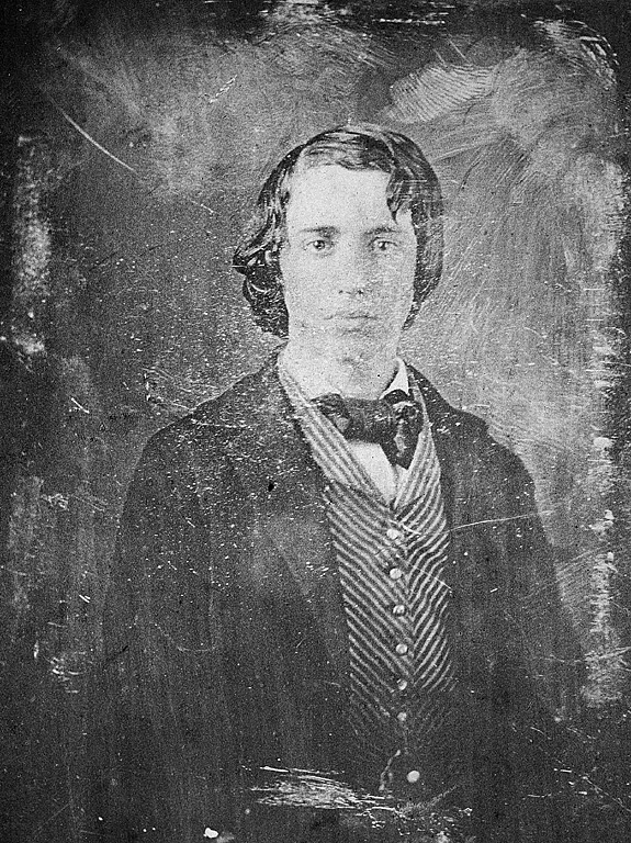 damaged photo of young man