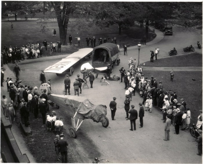 Historic photo of plane arriving at Smithsonian on truck bed