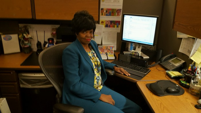 Carolyn Adams at desk