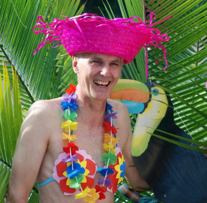 Briggs wearing pink hat and leis