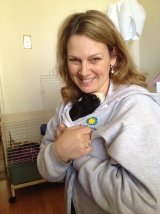 Maria cuddling small animal