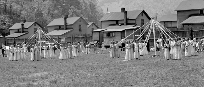 Cropped photo of women around May poles