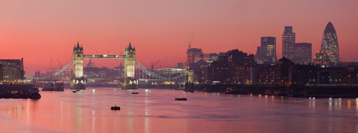 Panoramic view of London at sunset with Tower Bridge in the midground