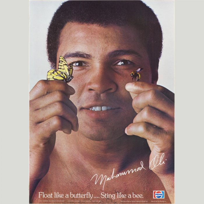 Photo of Ali with a butterfly and a bee