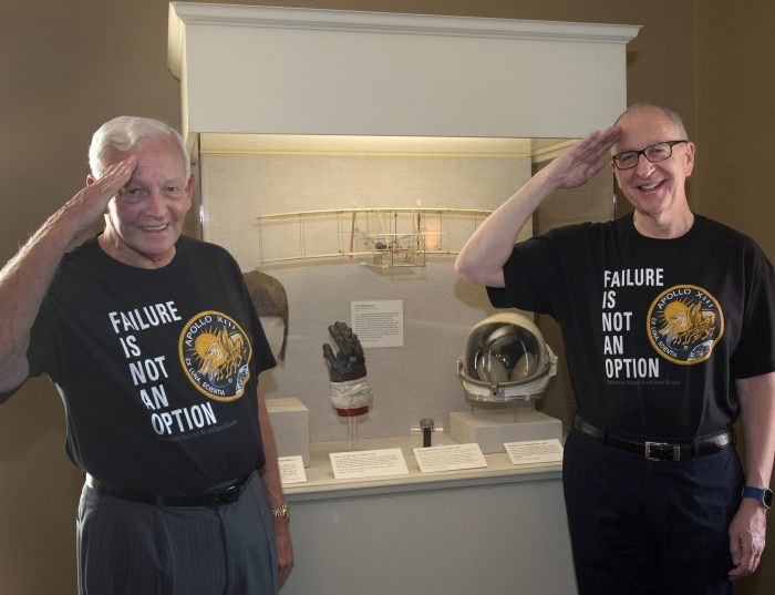 Dailey and Skorton saluting and smiling, while wearing Failure is not an option shirts