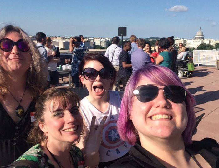 Four guirls pose for selfie with US Capitol in the background
