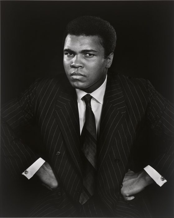 Black and white portrait of Ali with hands onhips