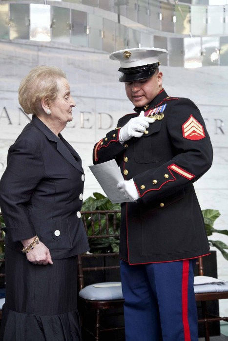 Madeleine Albright admires Sgt Luhan's medals