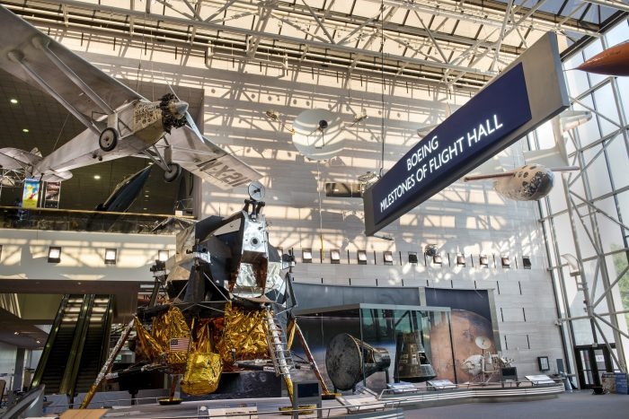 Broad view of Milestones of Flight exhibition hall with lunar lander in foreground