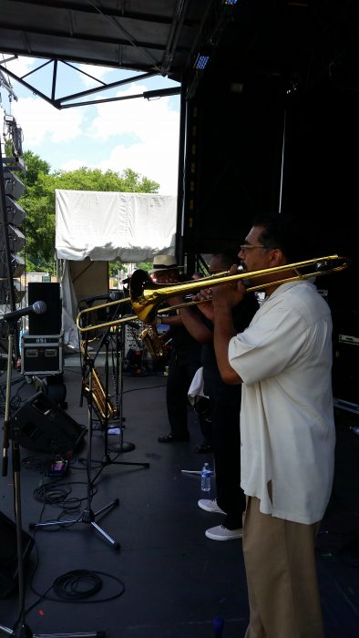 Side view of trombonist on stage