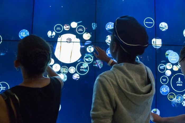 Children using giant touch screen