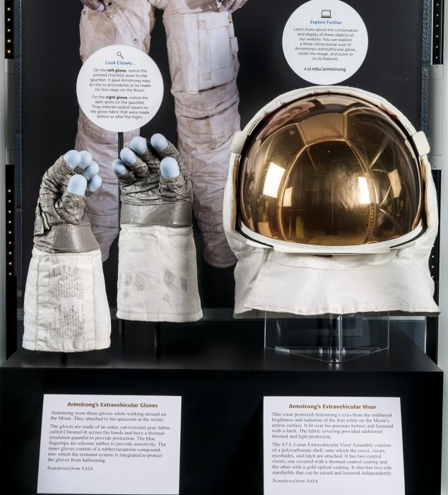 Exhibit case with spacesuit, gloves and helmet