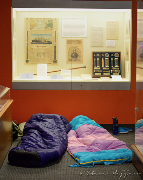 Sleeping bags in front of exhibit case